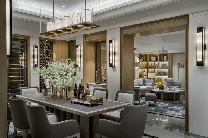燈飾具有濃烈的中式元素風格,布藝的家具搭配不規則石材地磚,讓整個家中被非常有質感!